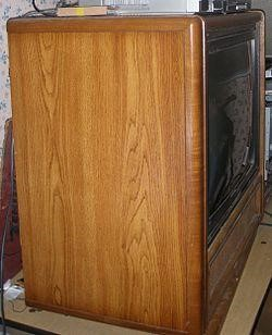 A cabinet with veneer wood paneling