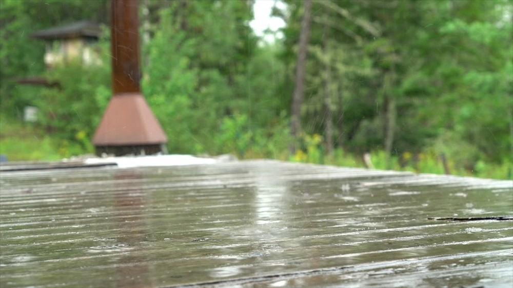 How to fix the deck when rain poured over the wet stain?
