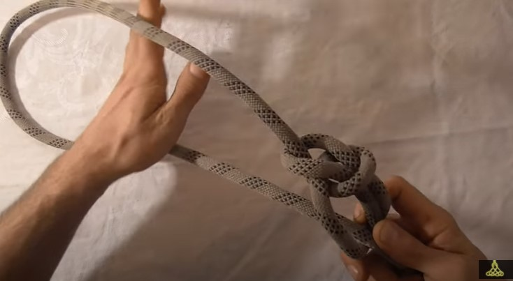 Running bowline knot to tie the swing to the tree trunk