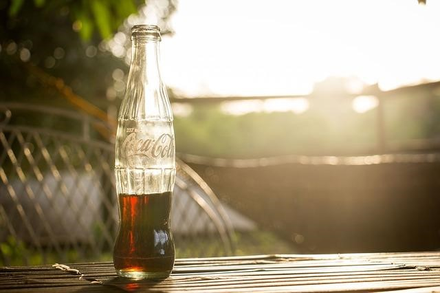 Use cola to remove rust from garden tools