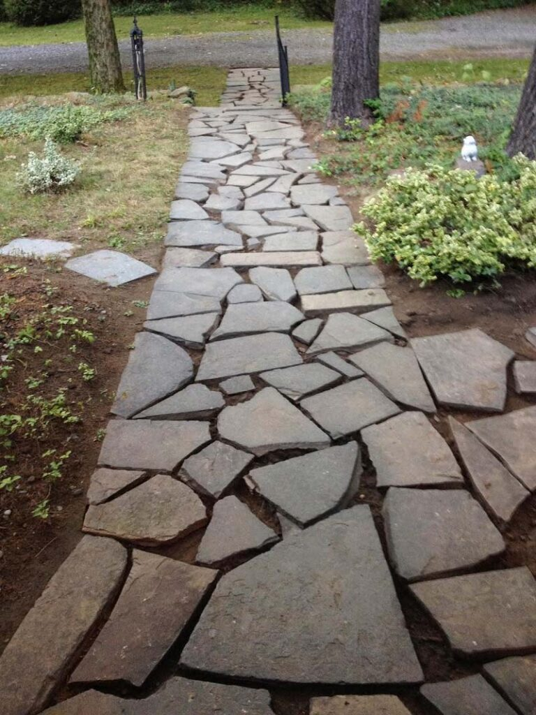 Using flagstones to fix muddy backyard dog trail